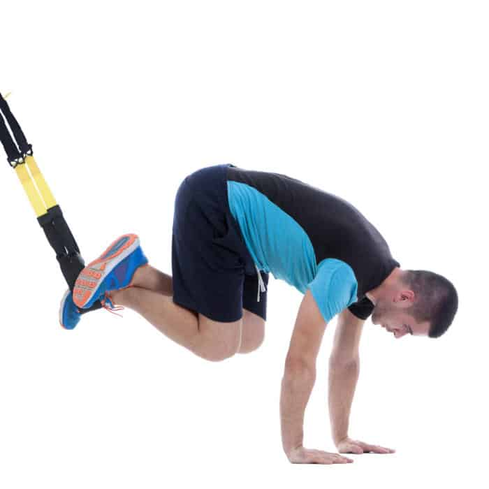 Man performing TRX-Jacknife