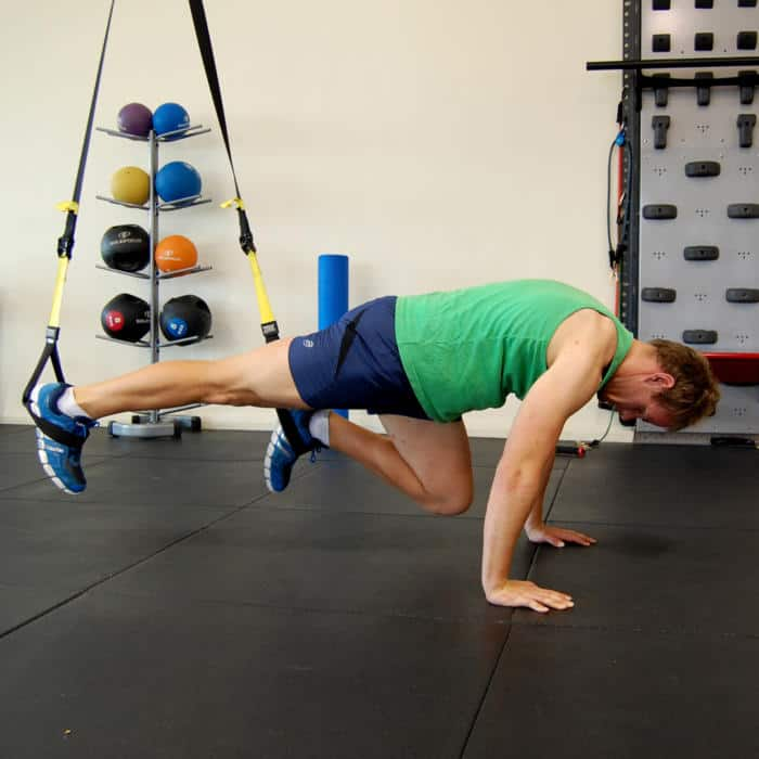 Man performing the TRX mountain climber